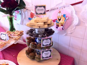 Polka Dots Birthday Themed Party. Table full of food. 4 tiered dessert stand.