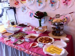 Polka Dots Birthday Themed Party. Table full of food.