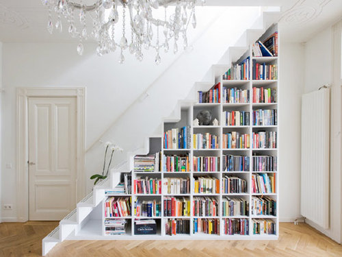 5 Things You Didn't Know Your Stairs Could Do. Library under the staircase.
