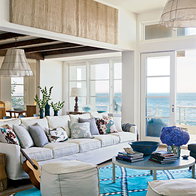 Top Eight Home Interior ... 1 Color, color, color. Beach house. Turqouise carpet, white walls with some wood. white sofa in a white beach house.