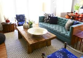 Top Eight Home Interior ... 8 Wood. Wood furniture with turqouise tuffted sofa and cream carpet.