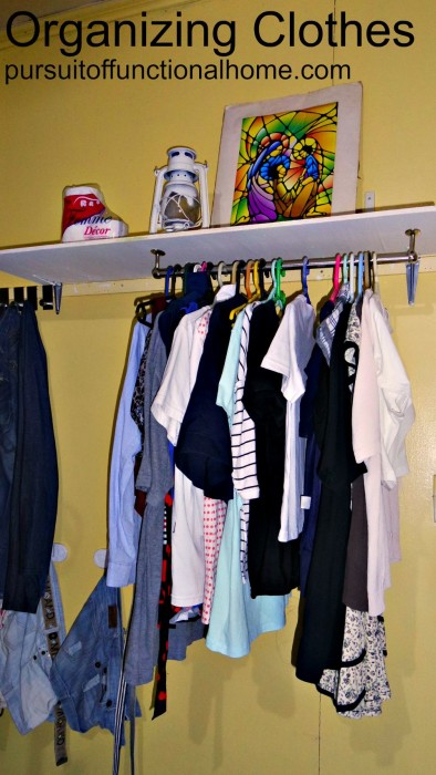 using wall as extra clothing storage, how to organize clothes, sneaky way to utilize bedroom space, organizing clothes