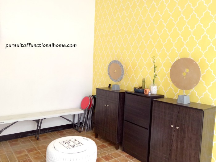 Yellow wall garage, stenciled wall garage, game board for garage, garage townhouses, town house, garage cebu city, fun garage, colorful garage, yellow garage, how to organize shoes